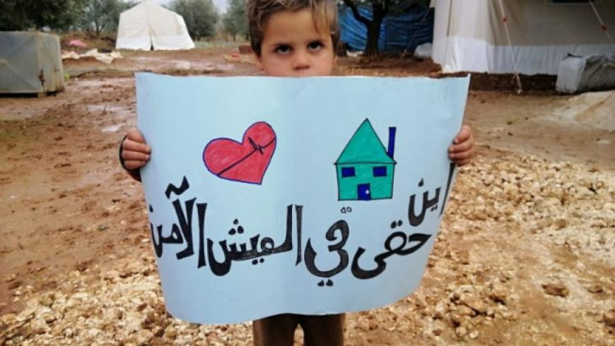 syrian-child-with-sign-750x563.jpeg